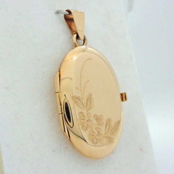 Kultainen avattava medaljonki 25 mm.