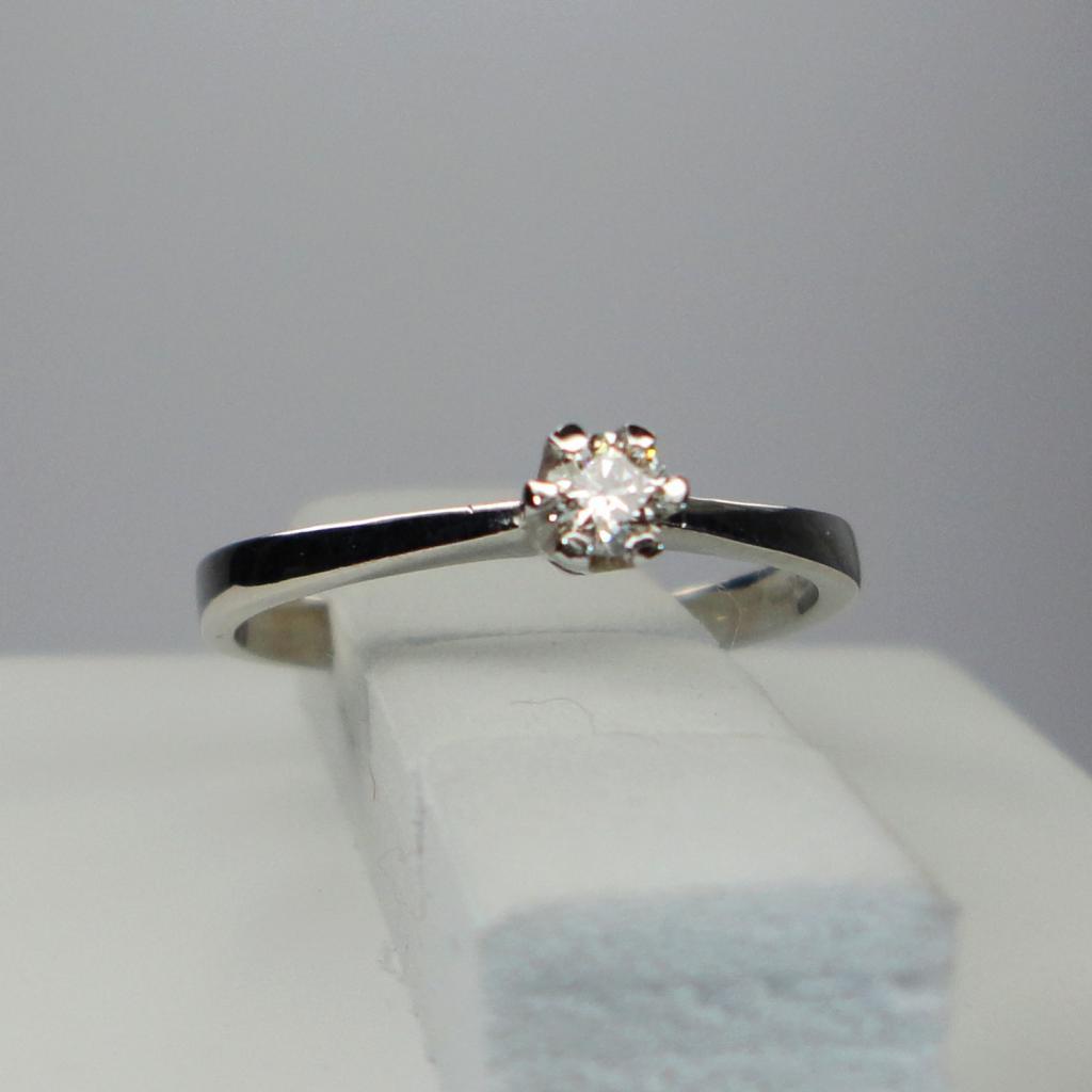 1-kivinen valkokultainen timanttisormus 0.10 ct tw/vs